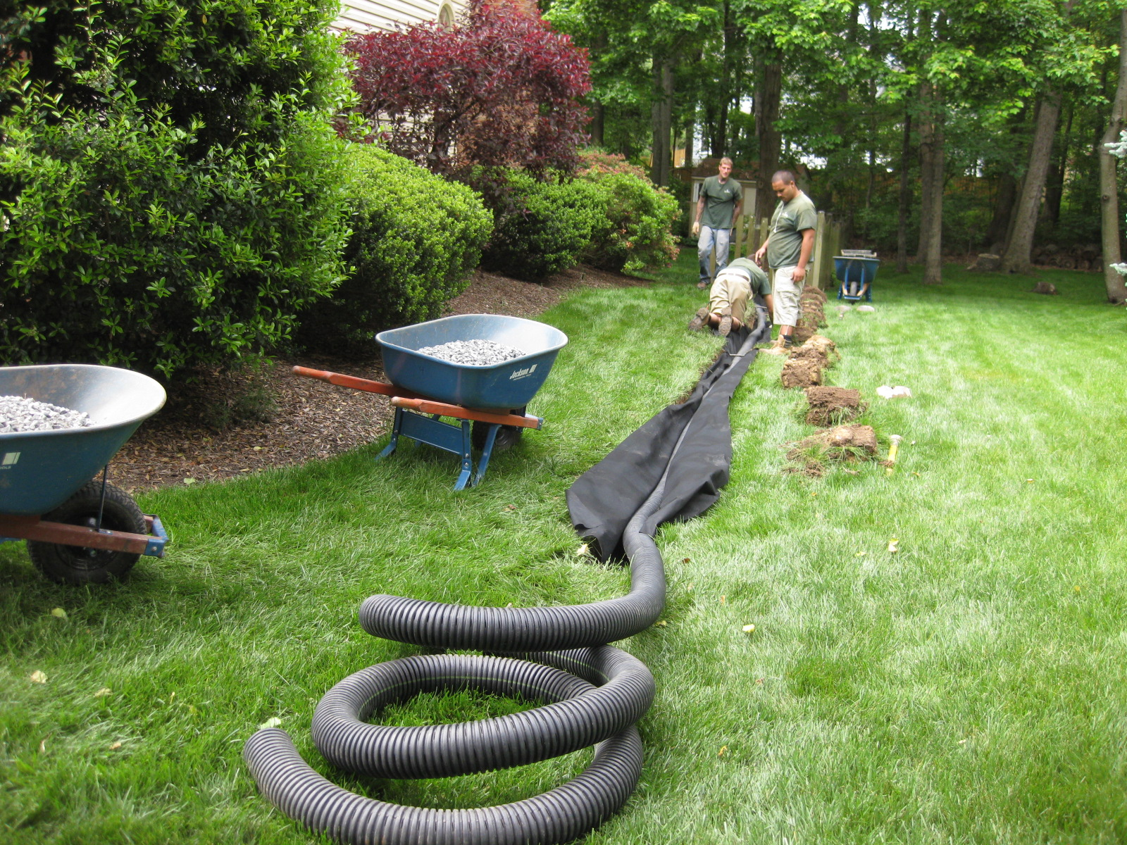 Installing A French Drain In Backyard drainage installation manassas va | four brothers tree & landscaping